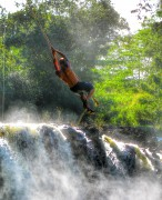 Rope Swinging into a waterfall Hawaii